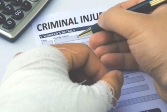 injured man completing a Criminal Injury Claim